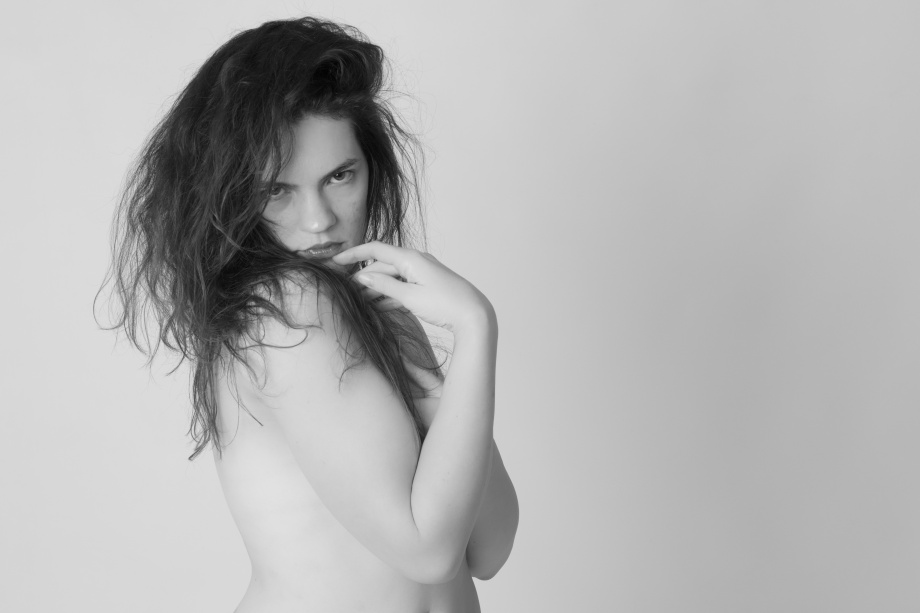 Glamour, black and white, no makeup, cork, topless, implied